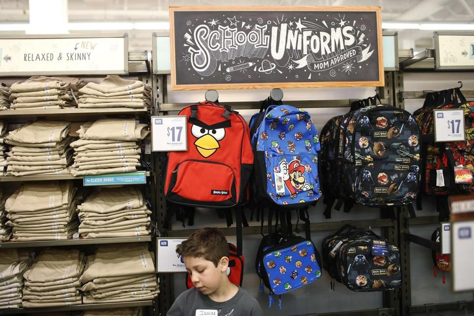 Isaias Zanella, 9, looked at clothing for school at an Old Navy store in San Jose, Calif. The chain's owner, Gap Inc., was among retailers that reported lower-than-expected revenues.