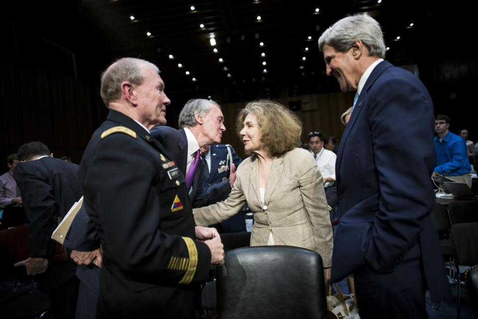 Chairman of the Joint Chiefs of Staff Martin E. Dempsey, left, and Secretary of State John Kerry waited while Senator Ed Markey and Teresa Heinz Kerry greeted each other on Capitol Hill Tuesday.