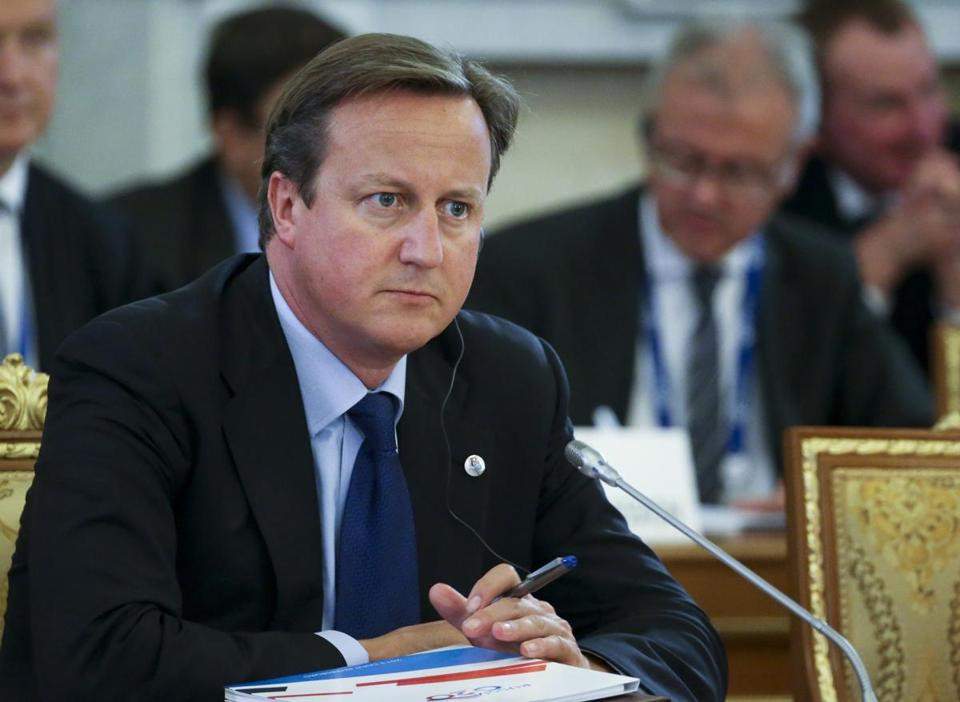 British Prime Minister David Cameron listened during a roundtable meeting at the G-20 summit in St. Petersburg, Russia.