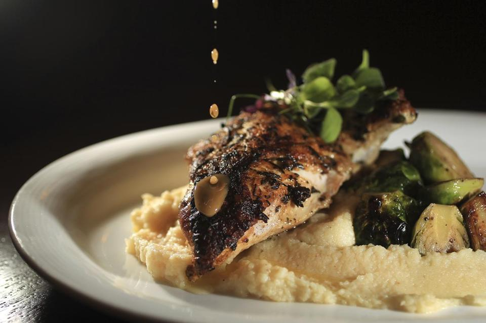 Chicken under a brick with celery root puree and Brussels sprouts.