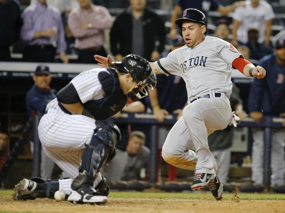 Jacoby Ellsbury didn't beat the throw home, but he slid in safely for the go-ahead run as the ball was short-hopped to catcher Austin Romine in the 10th.