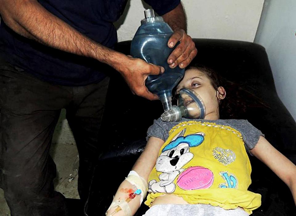 A Syrian girl received treatment at a makeshift hospital in Damascus on Aug. 21. Hundreds of people flooded into hospitals that day; reports said more than 1,400 people, including hundreds of children, were killed in the alleged chemical attack.