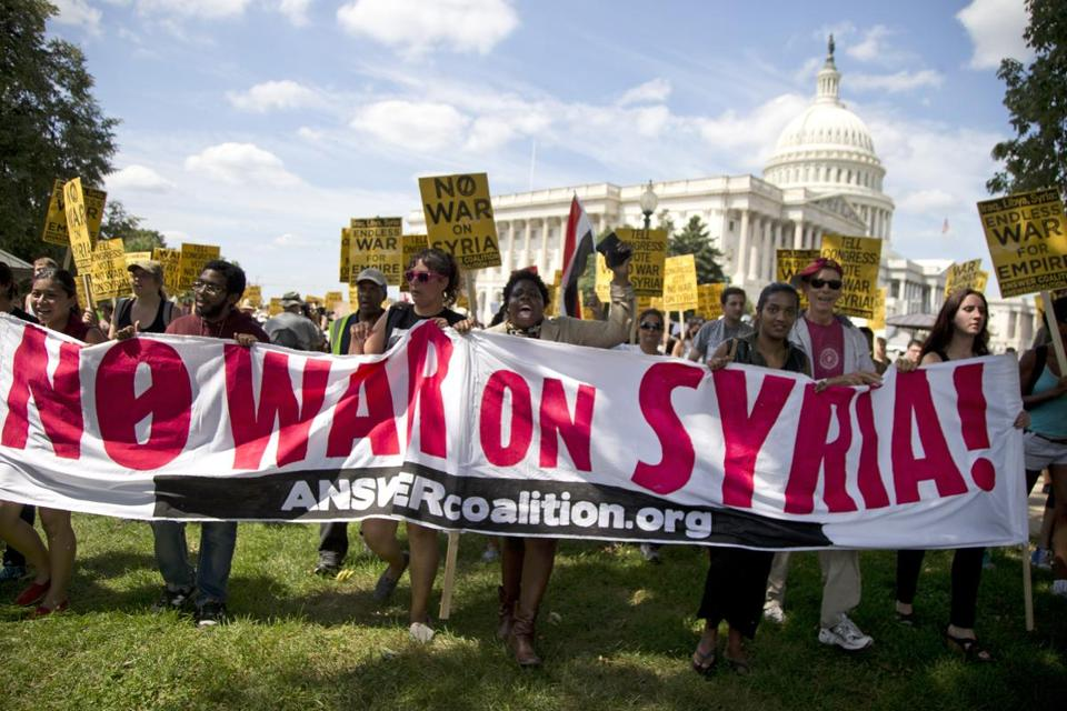 A group against US military action in Syria marched to Capitol Hill on Saturday.