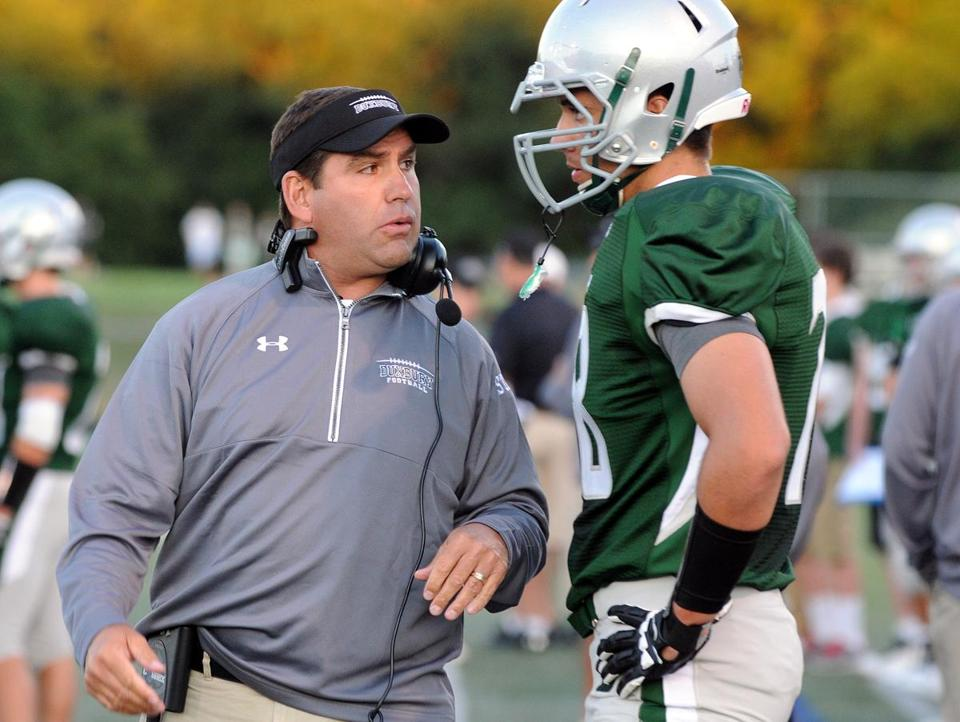 Duxbury head coach Dave Maimaron talks to one of his players, Liam Barry, last Friday.