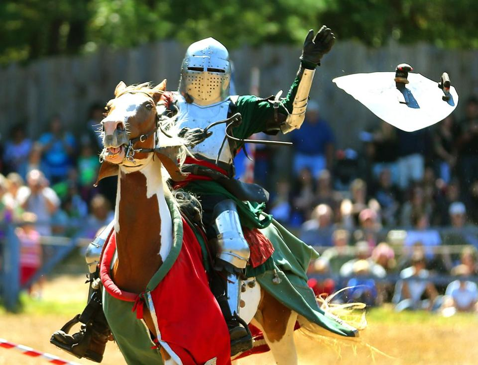 A knight's shield goes flying during a recent jousting contest at King Richard's Faire, an annual festival in Carver that is working with a regional organization to widen its audience.