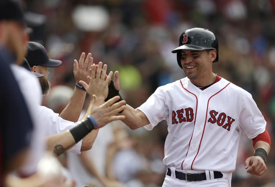 Jacoby Ellsbury was welcomed to the dugout after scoring against the White Sox at Fenway Park on Sept. 1.