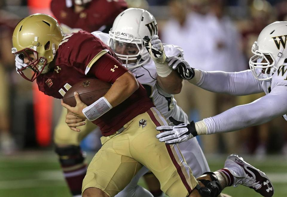 Boston College quarterback Chase Rettig scrambled under pressure in the third quarter.