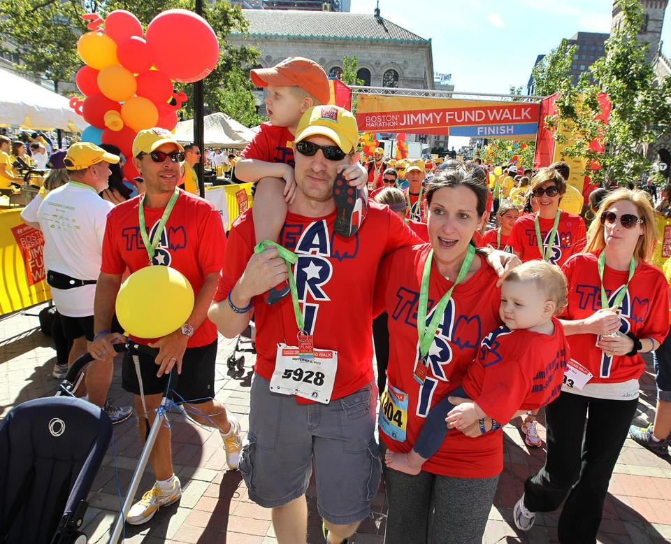 Team Ari of Newton was all family: Matt (with Ari) and JulieSue Goldwasser (with Ali) in the Boston Marathon Jimmy Fund Walk.