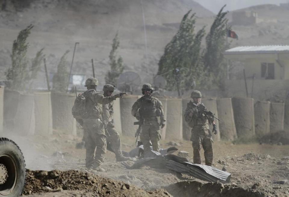 US troops serving with a NATO-led force investigated the site of a suicide attack east of Kabul on Sunday.