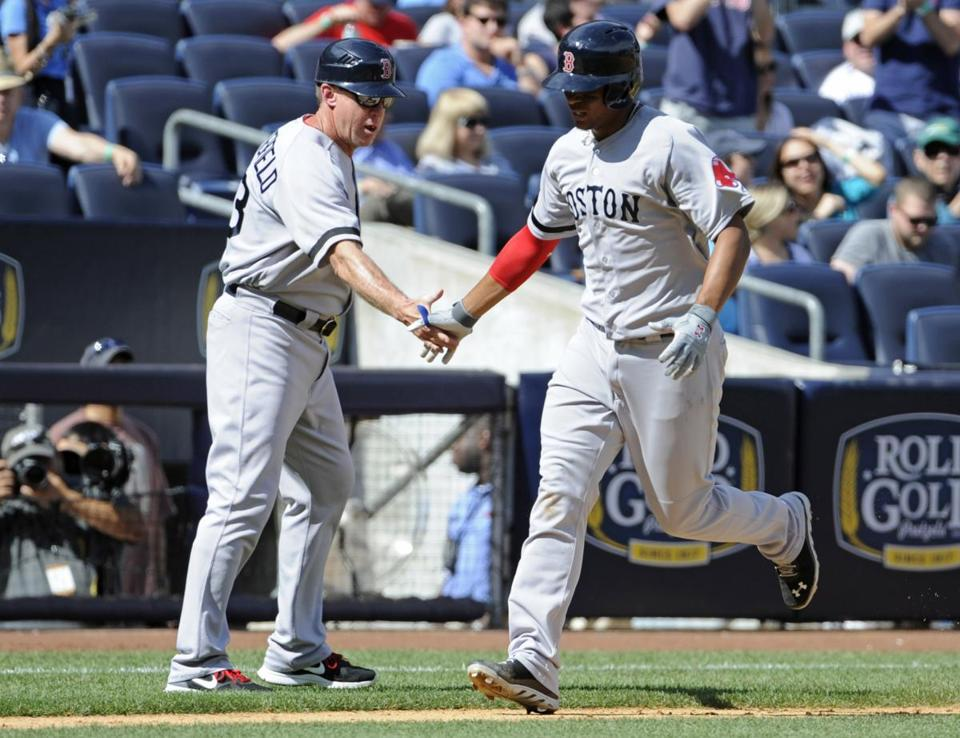 Third base coach Brian Butterfield (left) congratulated Xander Bogaerts after the 20-year-old's first major league home run.