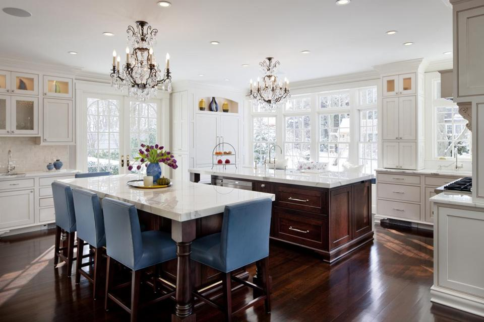 Chandeliers provide a subtle clue to the kitchen's original purpose: dining room. Now the sunny space sees constant use.