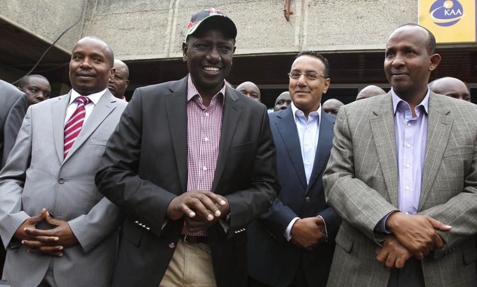 Kenya's deputy president, William Ruto (center), is accused of ordering ethnic mobs to hack political rivals to death.