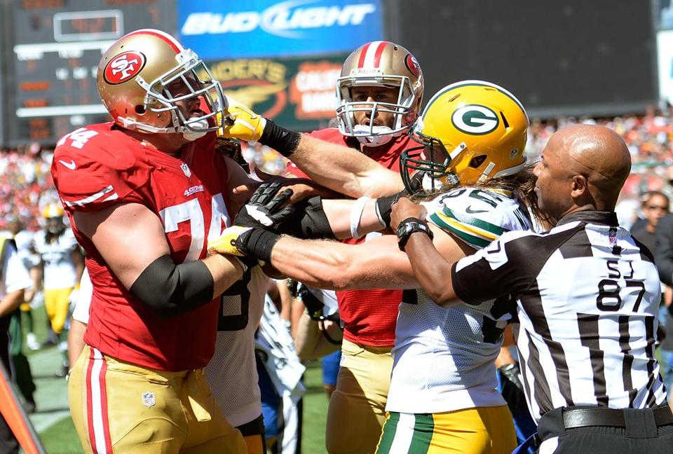 Coming to the defense of his quarterback Sunday, 49ers tackle Joe Staley (left) mixes it up with Clay Matthews.