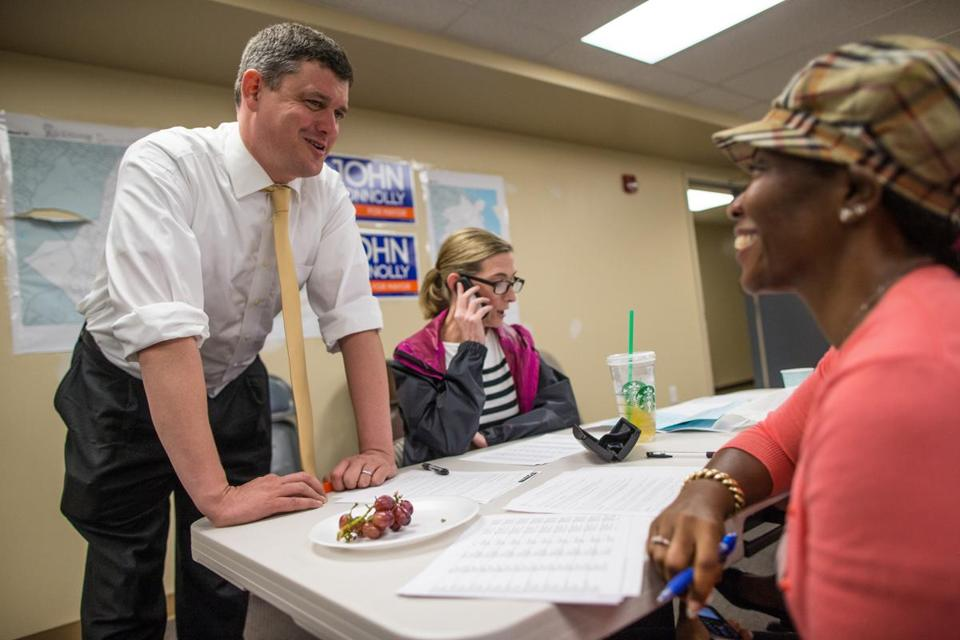 Mayoral candidate John Connolly spoke with volunteer Brenda James in his Mattapan campaign office.