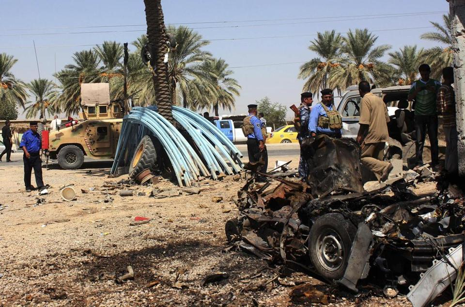 Members of Iraqi security forces inspected the site of a bomb attack in the village of Anbakiya in Baquba, roughly 35 miles northeast of Baghdad, on Tuesday.