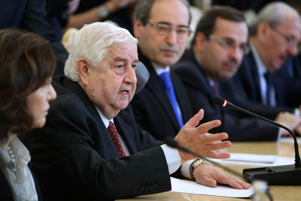 "Syria's foreign minister, Walid al-Moualem (left), said that President Bashir Assad was prepared to accept the Russian proposal to swiftly relinquish control over his arsenal of poison gas. ""We agreed to the Russian initiative,"" Moualem said."