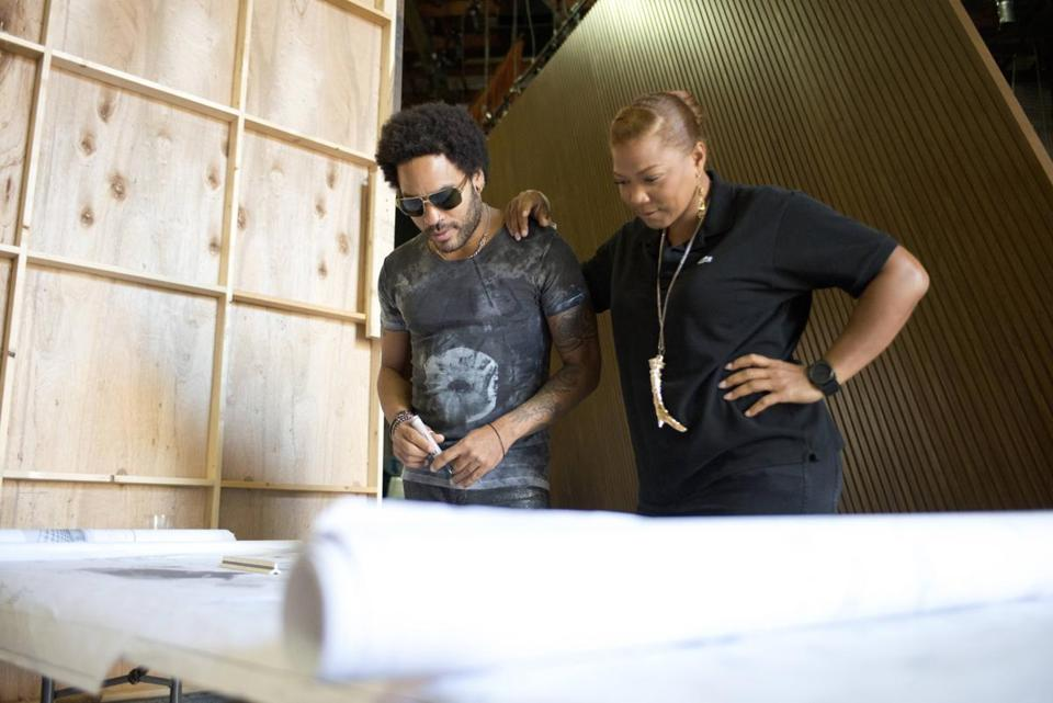 In July, Queen Latifah and singer-songwriter Lenny Kravitz looked over plans for the Kravitz-designed set of her new daytime TV talk show.