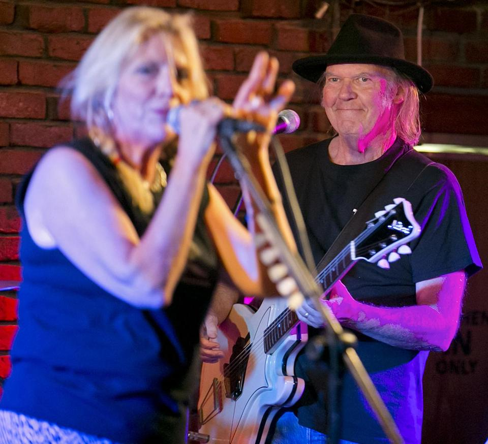 Neil Young, right, joined his wife Pegi on stage at Johnny D's in Somerville Wednesday night.