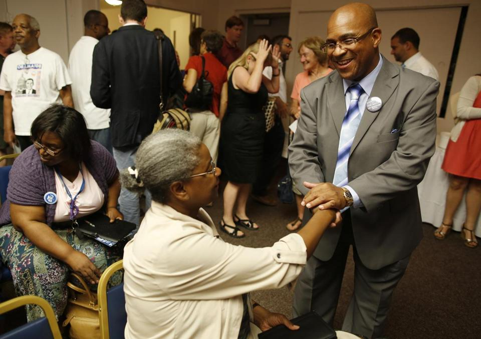 Mayoral hopeful Charles Clemons greeted teacher Susan Smith at a recent candidates' forum in Dorchester.