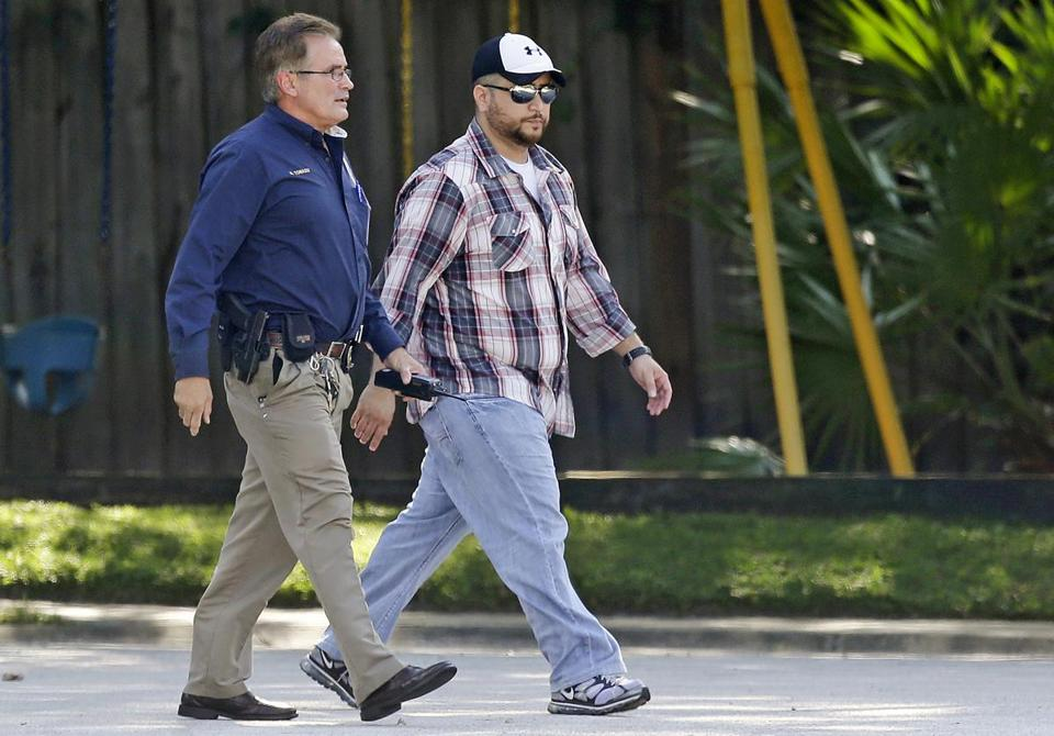 A police officer escorted George Zimmerman home after Monday's confrontation in Lake Mary, Fla.