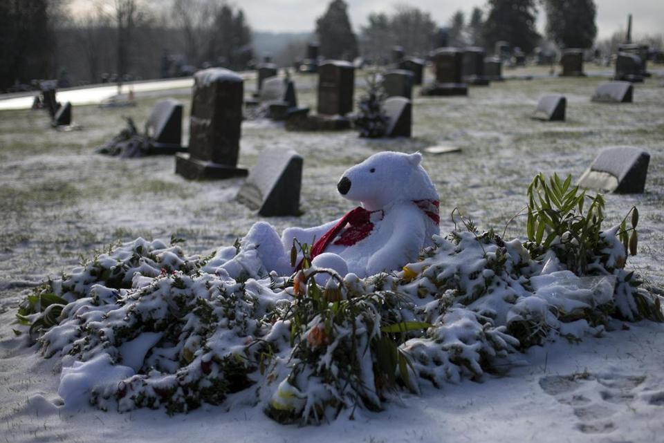 A teddy bear rested atop the snow-covered grave of 6-year-old Benjamin Andrew Wheeler in Newtown.