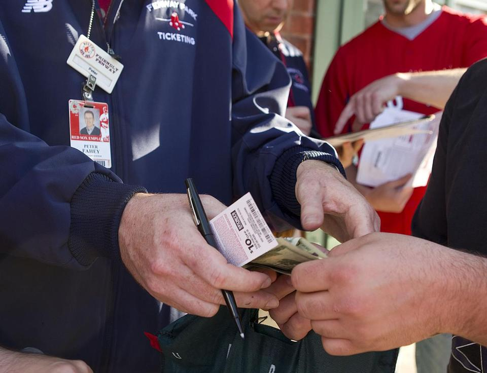 5/12/12 Boston, MA Red Sox employee Peter Fahey brokers a deal to sell tickets from season ticketholders with excess tickets to fans Story is about season ticket holders trying to get rid of tickets, and we need photos of the ticket holders as they try to sell their tix. Gate C at Fenway Park on Landsdown Street Êis the Scalp Free Zone where ticketholders can sell their tickets at face value or less