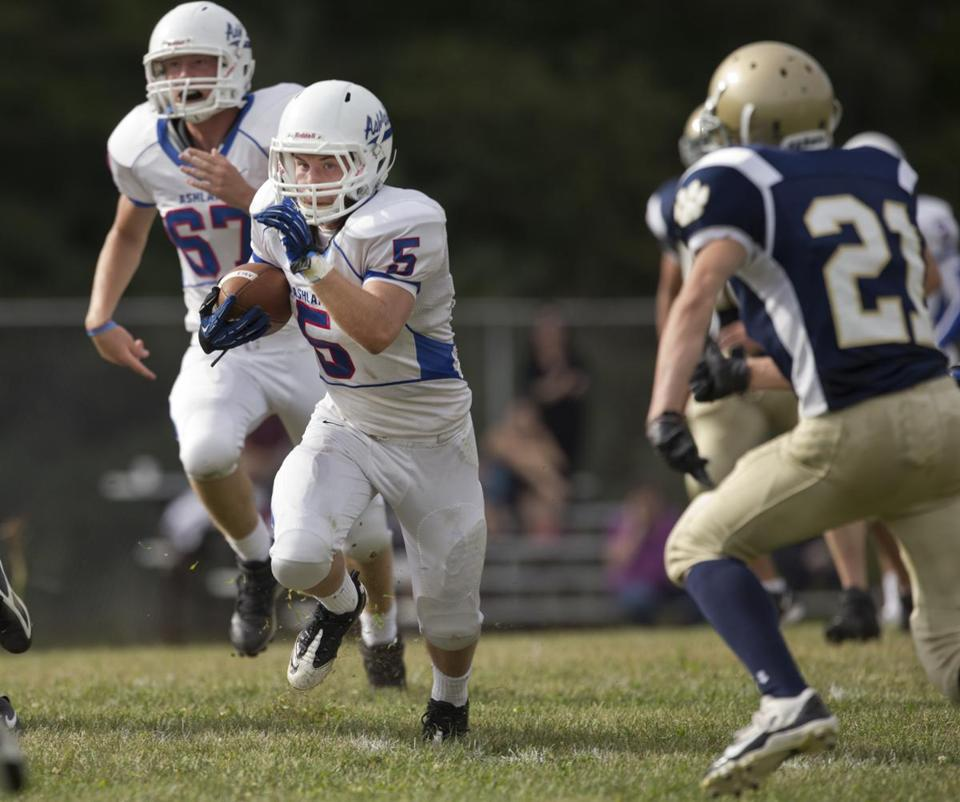 Ashland running back Paul Ferrier sprinted past Tri-County's Andrew Blacker during Friday's 45-0 victory. Ferrier finished with 112 yards rushing.