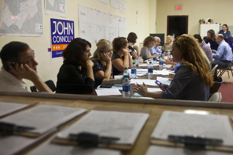 Volunteers for John Connolly worked their cellphones beforeameeting in the Roslindale field office.