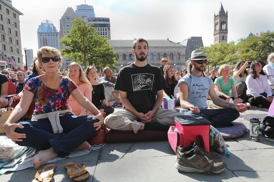 Among those who flocked to Copley Square on Sunday to hear Thich Nhat Hanh were, from left, Carol Hudgins of Cincinnati, Jim Piermarini Jr. of Amesbury, and Drew Amabile of Cambridge.