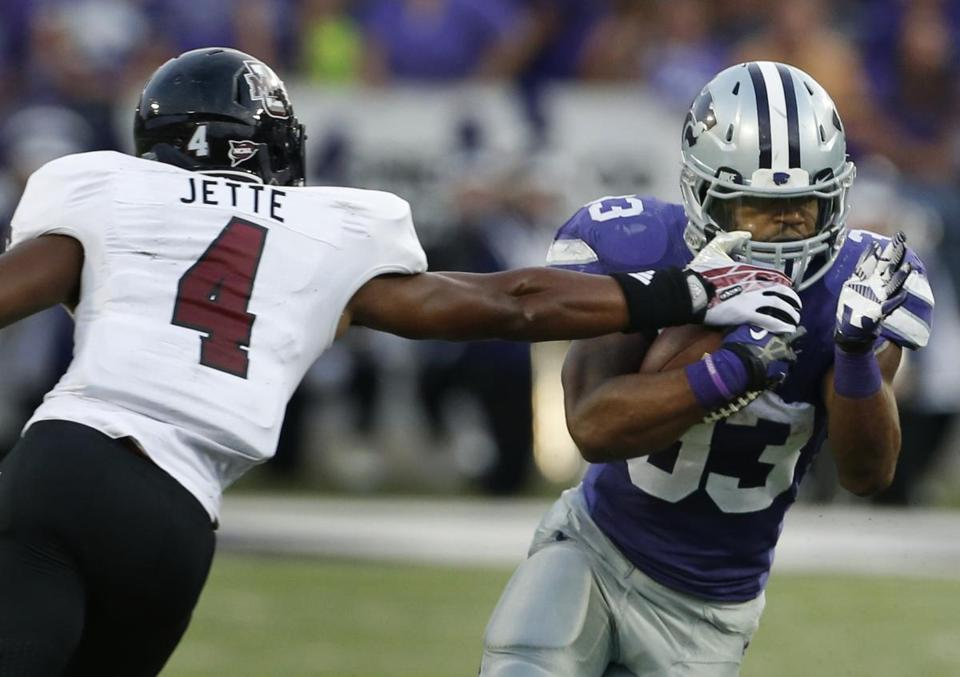 UMass defensive back Randall Jette got part of his hand on the face mask of Kansas State's John Hubert.