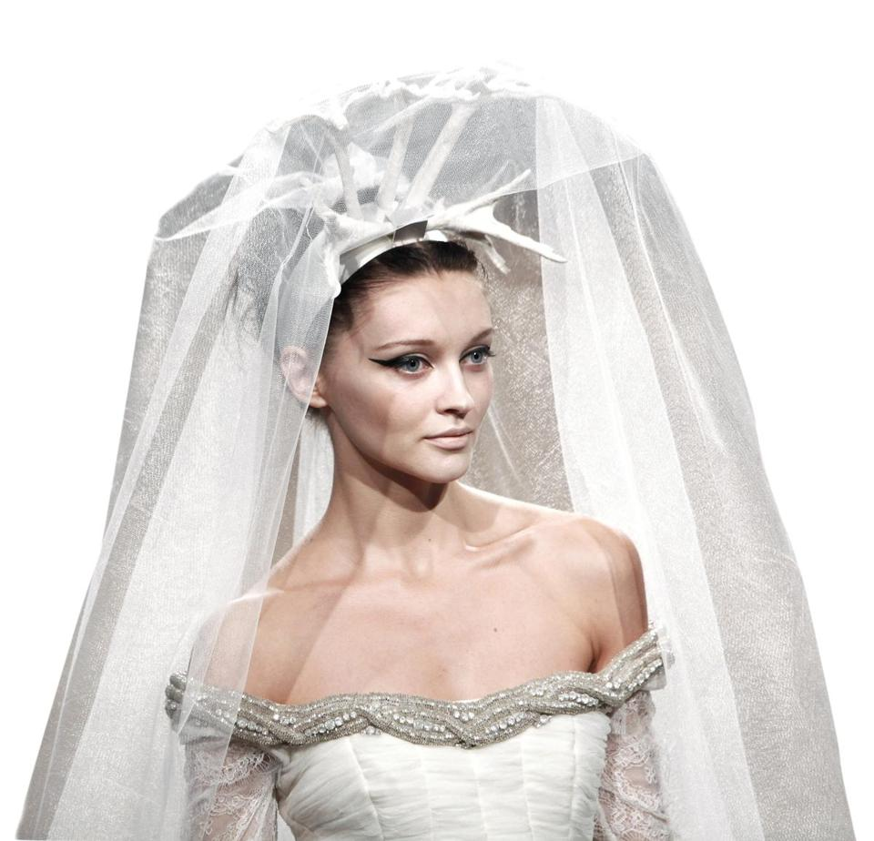 A model wore a wedding dress that featured an antler-like headband holding up the veil, in Paris in July.