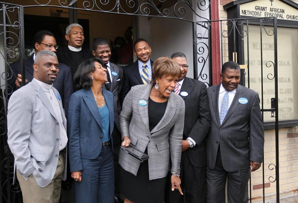 Nine prominent black ministers said Charlotte Golar Richie (front, second from left) has the experience and temperament to lead Boston.
