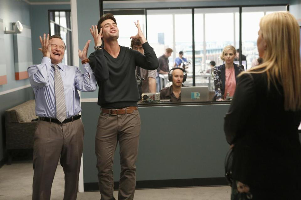 "James Wolk (right) with Robin Williams in ""The Crrazy Ones."""