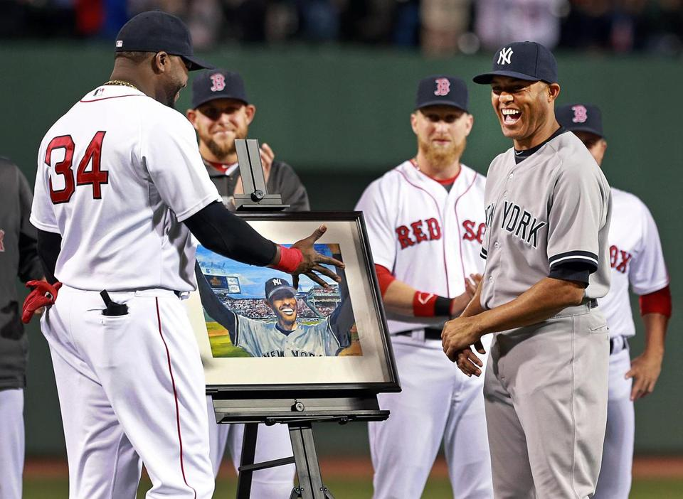 The Red Sox' David Ortiz presented Yankees legend Mariano Rivera with a painting depicting his famous response to the ovation he received at Fenway Park on Opening Day in 2005.