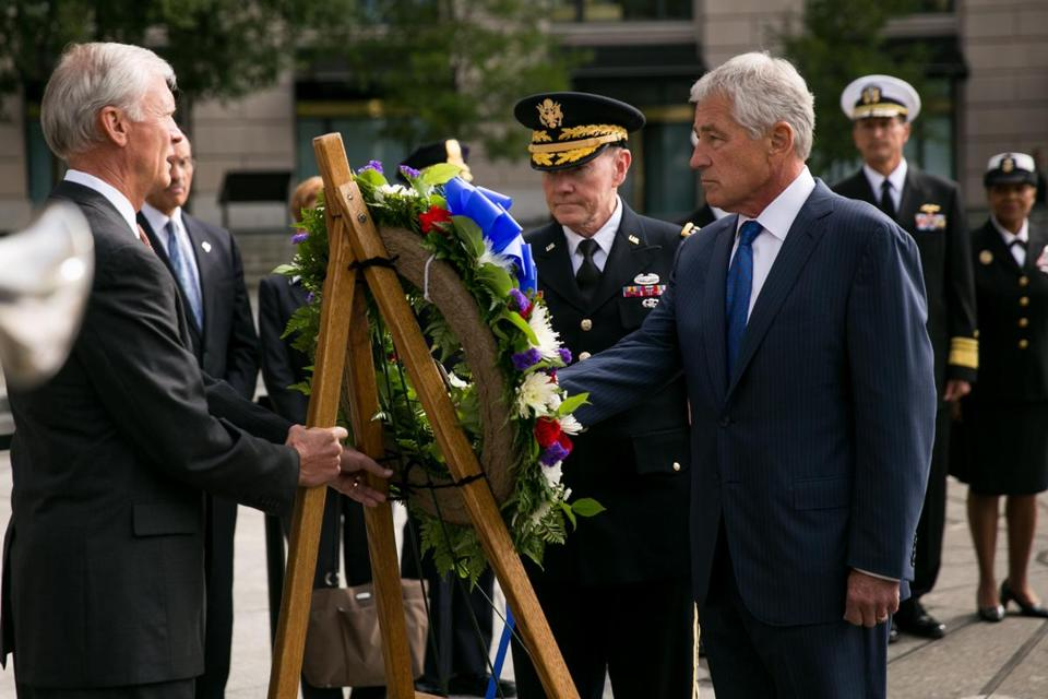 Defense Secretary Chuck Hagel laid a wreath Tuesday in honor of the Navy Yard shooting victims in Washington.