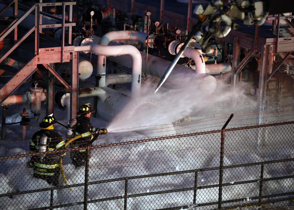 Fire crews worked to contain a fire at a fuel storage area at Logan Airport on Tuesday.