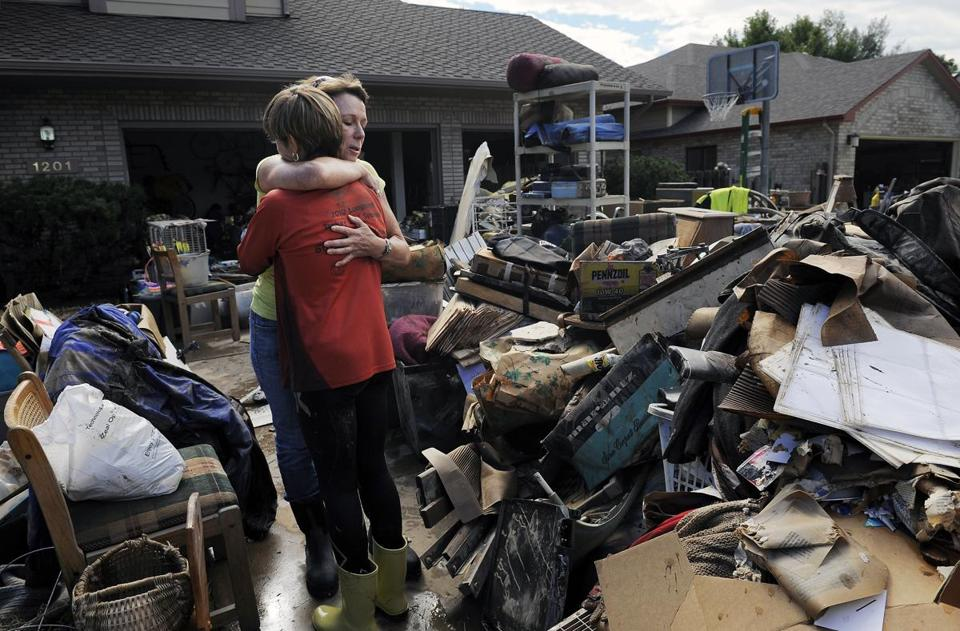 Chris Ringdahl (left) was hugged by Katherine MacIntosh in front of Ringdahl's possessions in Longmont, Colo.
