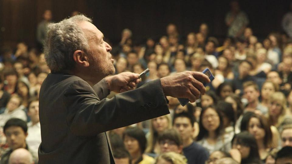 Lectures by Robert Reich figure prominently in the film.