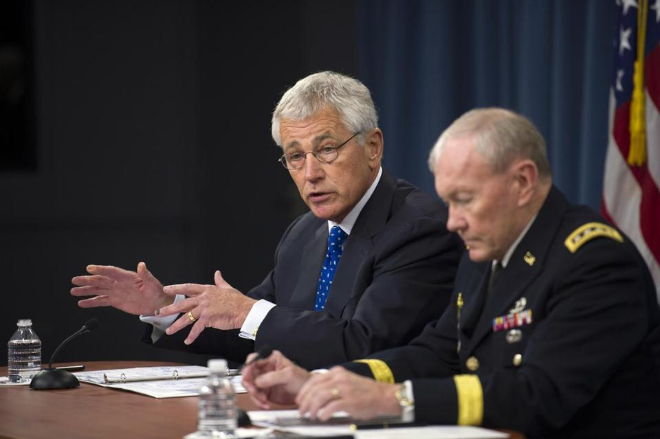 Defense Secretary Chuck Hagel (left) acknowledged that ''a lot of red flags'' may have been missed in the background of the Washington Navy Yard shooter.