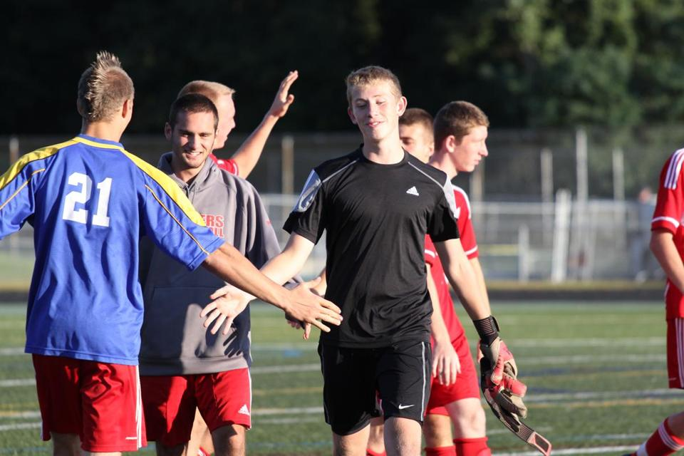 Silver Lake Regional senior keeper Stephen MacSwain  celebrates with teammates after Tuesday's win against Duxbury.