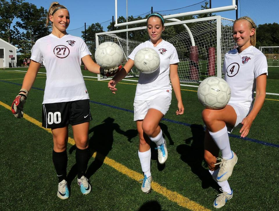 As captains of the Concord-Carlisle girls' squad, (from left) Angela DeBruzzi, Allie Barrett and Molly Whit-man are helping the team adapt to the new system used by first-year head coach Peter Fischelis.