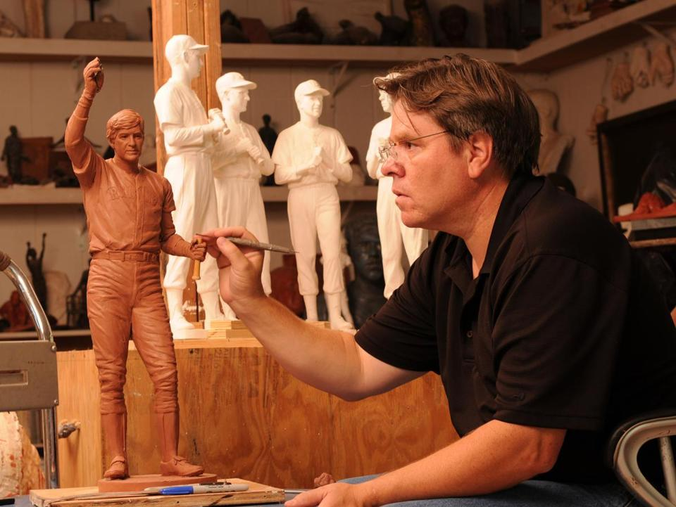 Toby Mendez works on a model of his Carl Yastrzemski statue in his Maryland studio.