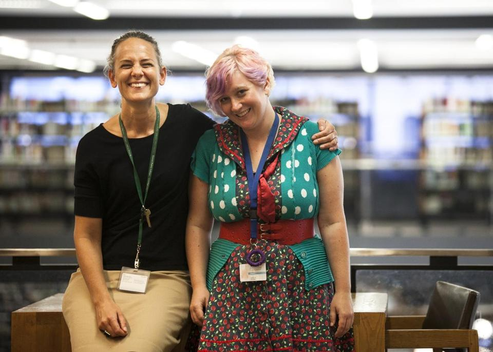 Librarians Jessi Snow (left) and Laura Koenig work with young adult readers at the Copley Library in Boston.