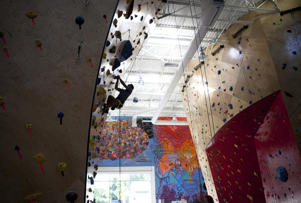 Tylor Hess climbed a rock wall at Brooklyn Boulders in Somerville.
