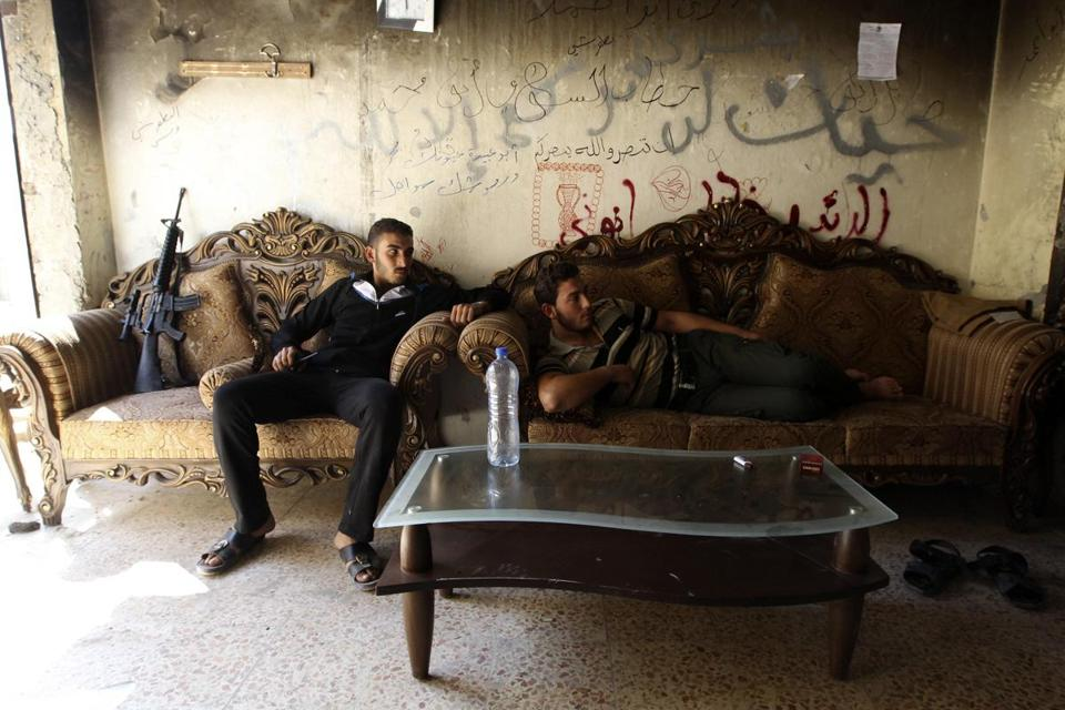 These Free Syrian Army fighters rested in Aleppo on Saturday. The Organization for the Prohibition of Chemical Weapons was reviewing a further disclosure on Syria's program.