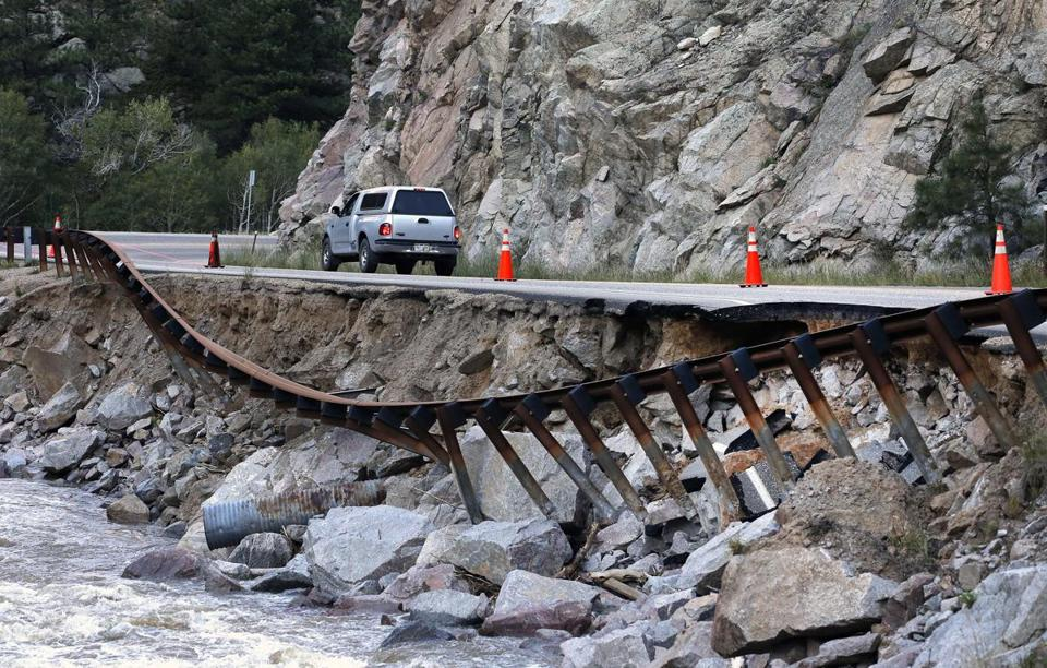 Some Colorado residents used a closed canyon road, which was washed out in places by flooding near Boulder .