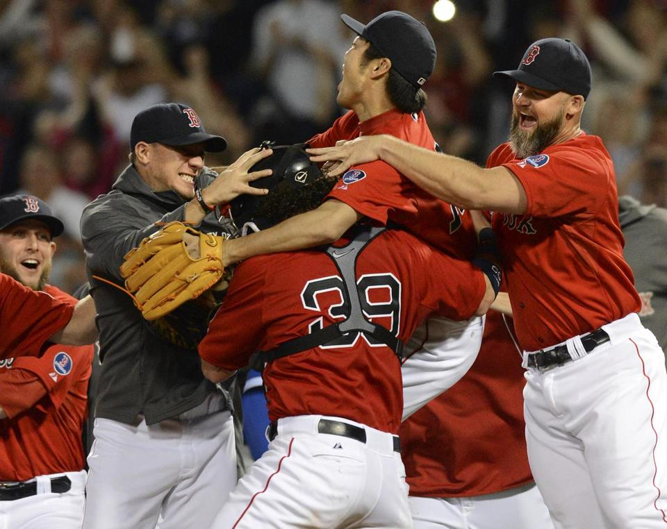 The Red Sox rushed out of the dugout to celebrate at the mound with closer Koji Uehara after they clinched the AL East title.