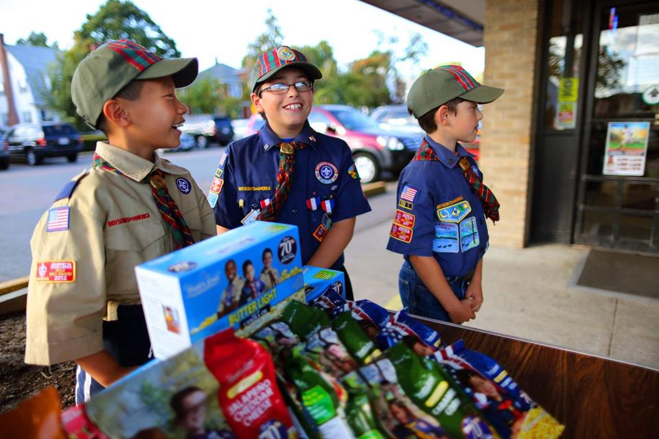 Cub Scout Pack 42 members (from left)  Dylan Mui,  Simon Ford, and Ian Gillespie, all age 9, wait for customers outside Atlas Liquors in Quincy.