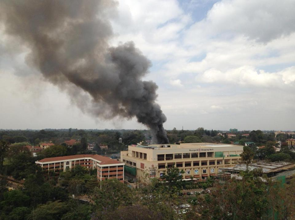 A cone of black smoke emerged from the Westgate shopping mall in Nairobi on Monday. The Islamist militants who carried out the attack at the mall, which killed at least 62 people, were still inside the building, despite the effort by hundreds of Kenyan troops to remove them.
