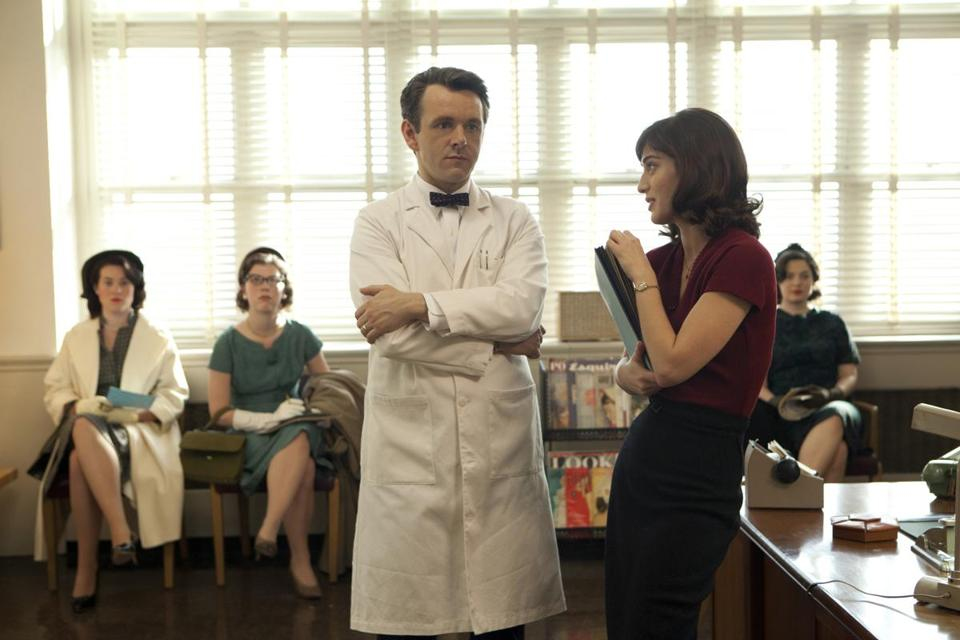 Michael Sheen and Lizzy Caplan play William Masters and Virginia Johnson. Below: Caitlin FitzGerald plays Masters's wife, Libby, and Nicholas D'Agosto Johnson's lover, Ethan Haas.
